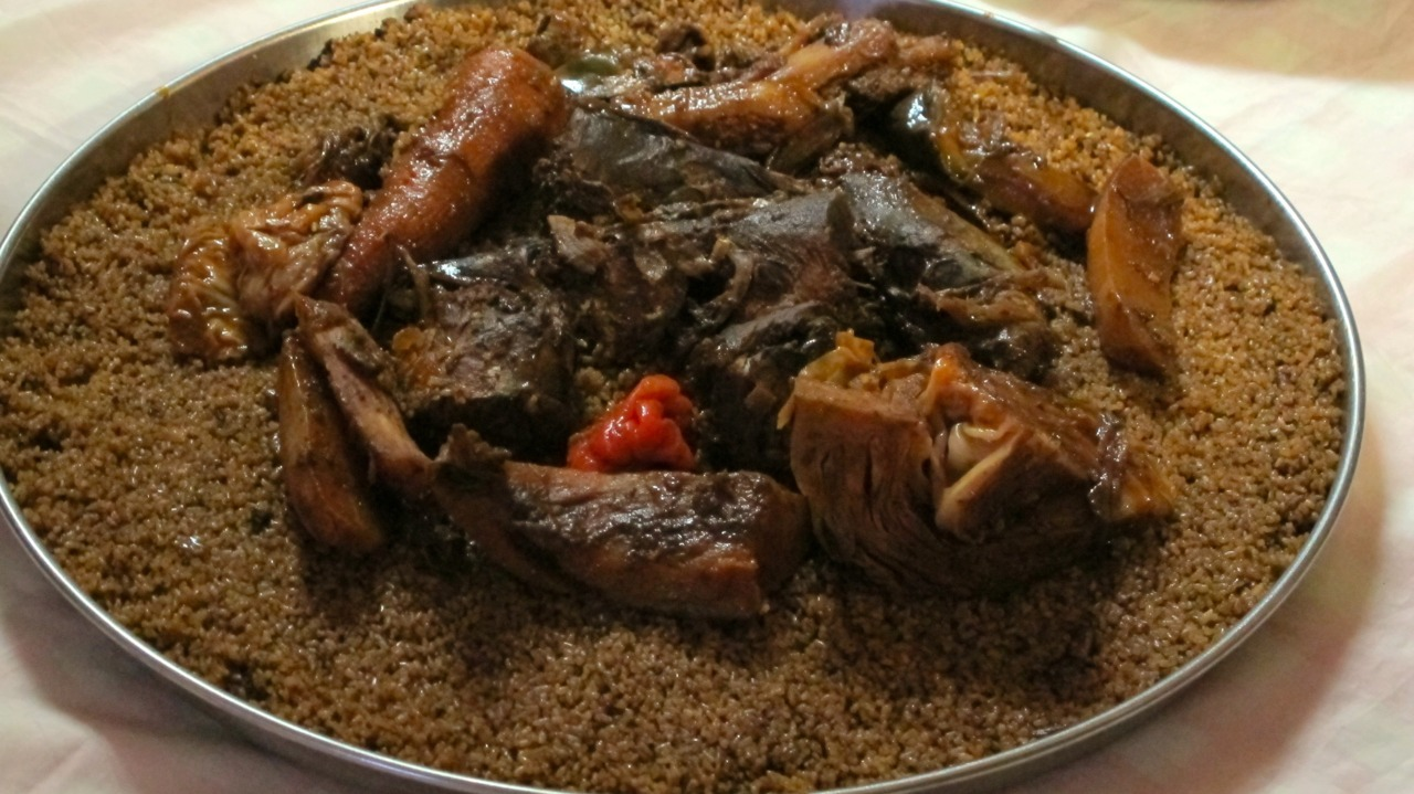 dynamicafrica:  Whether you spell it thieboudienne or ceebu jen, this hearty Senegalese meal made from fish, rice, tomato sauce and many other ingredients will still taste incredibly delicious. The name of the dish comes from Wolof, meaning rice and fish and is eaten throughout the country and Senegalese diaspora.