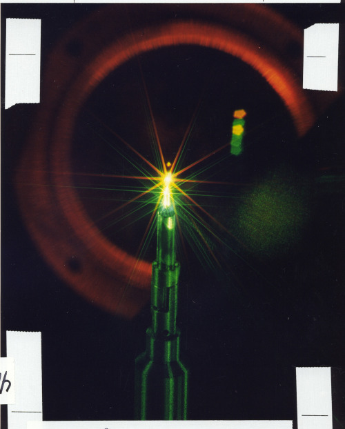 "Nova Laser Beam and Target creating a miniature star. In 1986, the Nova laser at Lawrence Livermore National Laboratory produced the largest laser fusion yield to date—a record 11 trillion fusion neutrons. This miniature ""star"" was created in the Nova laser target chamber as 300 trillion watts of power hit a 0.5-millimeter-diameter target capsule containing deuterium–tritium fuel. The first Tron movie used the Nova laser for its location shots. photo: llnl/flickr"