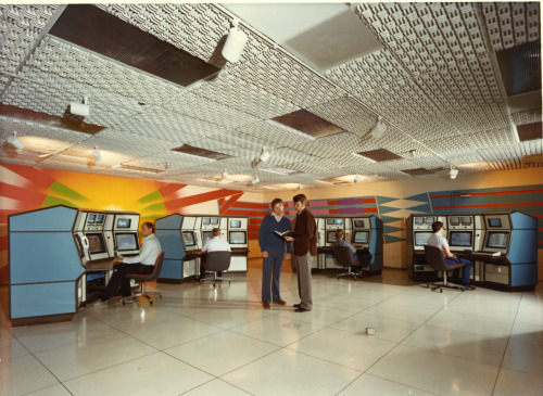 Nova Laser Computer Control Room, 1985. At the Nova laser, located at Lawrence Livermore National Laboratory, four identical operator consoles interchanged information with the laser's four subsystems – power conditioning, laser alignment, beam diagnostics and target diagnostics, to precisely control and monitor this complex, electro-optical system. What was at the time the world's largest and most powerful laser, Nova consisted of hundreds of moveable mirrors, motors, cameras, and mechanical devices which had to be precisely controlled and monitored. Approximately 50 Digital Equipment Corporation LSI-11/23 microcomputers and five VAX 11/780 computers made up the control system. The 50 micros, called front-end processors (FEP), were the system's chief building blocks. They were connected to nearly 5,000 control devices and sensors. Nova's control system had four subsystems that corresponded to the four major areas of the laser and a central control system to tie it all together. 1) The power conditioning system regulated the hardware that fired 150 disk amplifiers, 22 rod amplifiers and 42 Faraday rotators in the 10-arm Nova laser. 2) The laser alignment system steered the 10 Nova laser beams along their 250-meter paths. 3) The beam diagnostics system characterized each of the 10 laser chains at key locations measuring beam energy, pulse shape and timing, and positioning of the KDP frequency conversion crystals. 4) The target diagnostics system recorded signals from a wide variety of instruments. This system was flexible enough to accommodate different target designs and changing diagnostic needs. The first Tron movie used the Nova laser for its location shots. photo: llnl/flickr