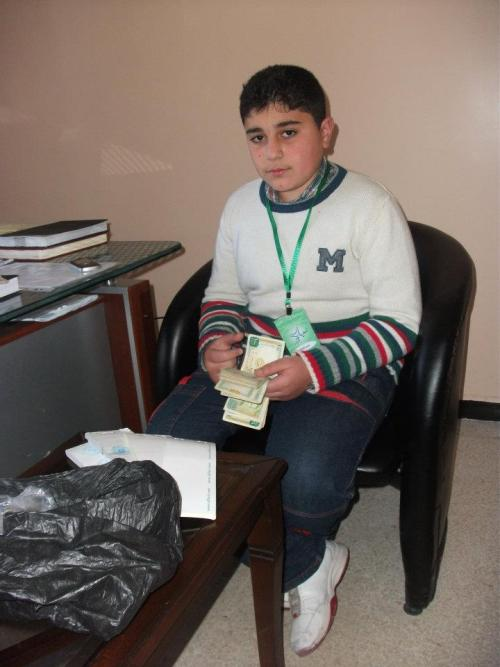 Young Homsi volunteer doing his best to help the families of Homs. God bless him. #Syria