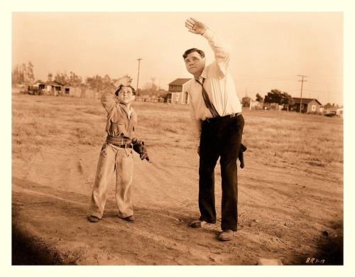 "1932 Play Ball With Babe Ruth: ""Slide, Babe, Slide"" Pt.2Universal Pictures Production Still #B.R.1-13 Here's another new edit originating from the Universal Pictures ""Play Ball With Babe Ruth"" short-film series. You can clearly see how Babe shredded his pants from his sliding lesson. I believe they've spotted a UFO in this one (or maybe a pop-fly is on the way)."