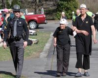 Anti-nuclear activists Francis Crowe, 93, of Northampton, center, and her friend Anneke Corbett are escorted off the property of the local corporate offices of Vermont Yankee owner Entergy Corp. on Thursday in Brattleboro, Vt., after being arrested for trespassing.