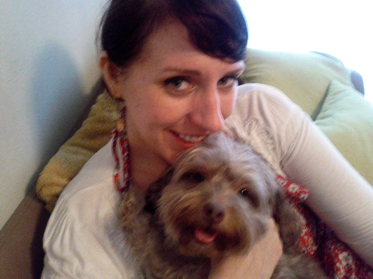Fuzzy Animal Friday! Annie and me on St. Paddy's Day. The photos aren't that great but I love how our expressions match, her little paw wrapped around my neck, and THAT FACE.  Precious.