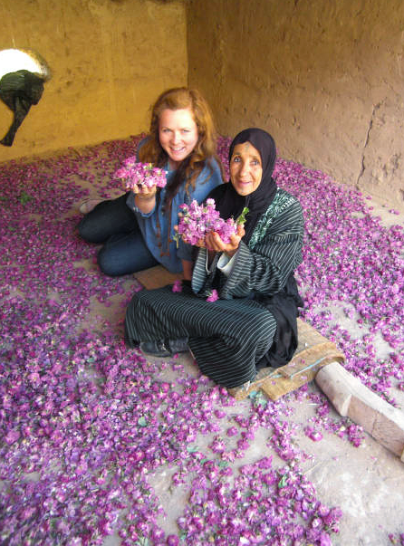 Mouhou Boussine, my counterpart, and I are sitting amongst her drying roses in the Valley of the Roses in Morocco. As a small business development Volunteer, I helped Mouhou develop the weaving association in the village. The weavers were all agrarian farmers and every spring, we woke at dawn to harvest roses which we often cooked into rosewater.  - Peace Corps Business Development Volunteer Terra Fuller