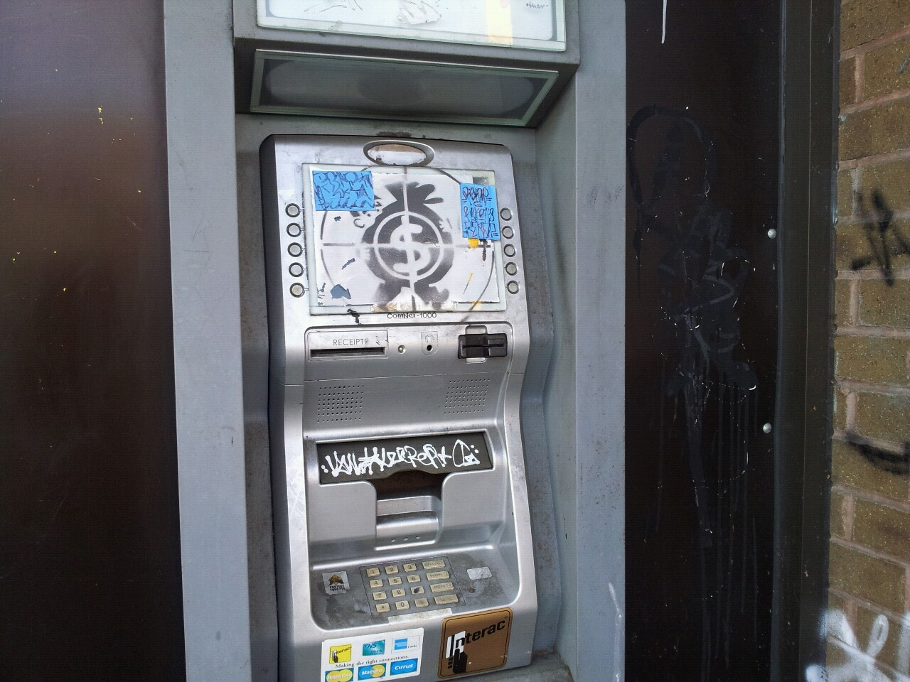 This abandoned cash machine has been accumulating art for years.