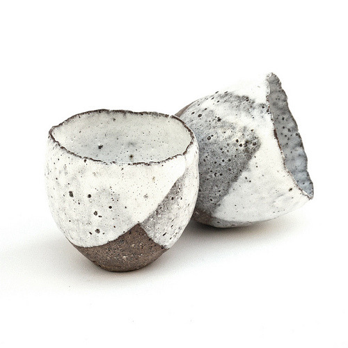 ofvessels:  artpropelled:  Sake Cups from the Rustic Ceramic Collection  (by nomliving.com)