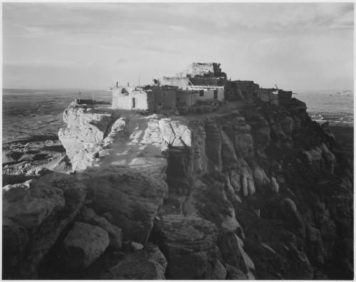 "Full view of the city on top of mountain, ""Walpi, Arizona, 1941.""  From: Series: Ansel Adams Photographs of National Parks and Monuments, compiled 1941 - 1942, documenting the period ca. 1933 – 1942 Created By: Department of the Interior. National Park Service. Branch of Still and Motion Pictures."