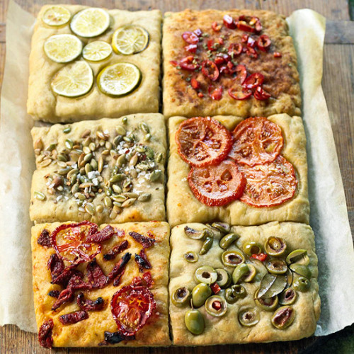 Daily Dish: Our No-Knead Focaccia Tiles only look tricky! Stretch dough into shape by hand then dress with briny olives, tomatoes, zesty citrus and roasted pumpkin seeds.