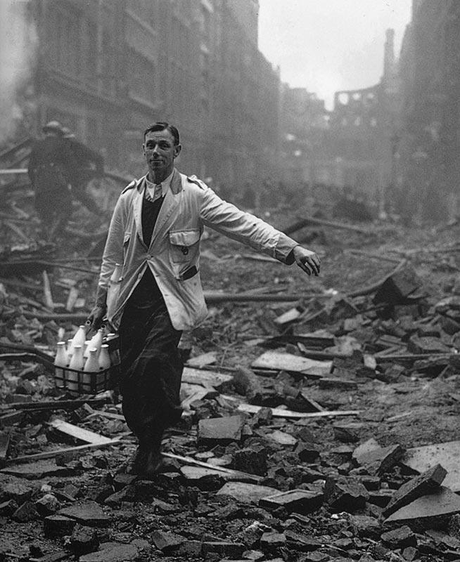 itsjohnsen:  A milkman delivering on a London street devastated during a German bombing raid. 1940. Fred Morley
