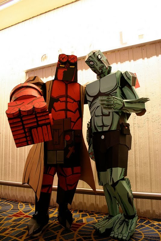archiemcphee:  Check out these incredibly awesome Cardboard Hellboy and Abe Sapien costumes spotted at the 2011 Dragon*Con! Both suits, at least one of which was made by Nikejerk3, are one-of-a-kind and sport such wonderful lines and colours, that they might as well have just stepped out of one of Mike Mignola's fantastic comic books. [via Super Punch]