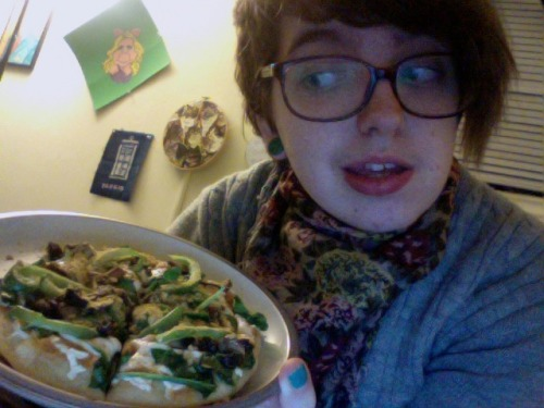 "reblogged from brohamsandwich:  Got home from making pizzas at work (holy crap busy) and made myself a mini-pizza out of leftover dough and stuff from making cat pizzas with ahhhna (those pics later probs). It has: roasted red pepper cream sauce (cashew based), mozzarella daiya, spinach, mushrooms, green bell pepper, red pepper flakes, and nooch.  I did not hear a single word you said after ""cat pizzas."""