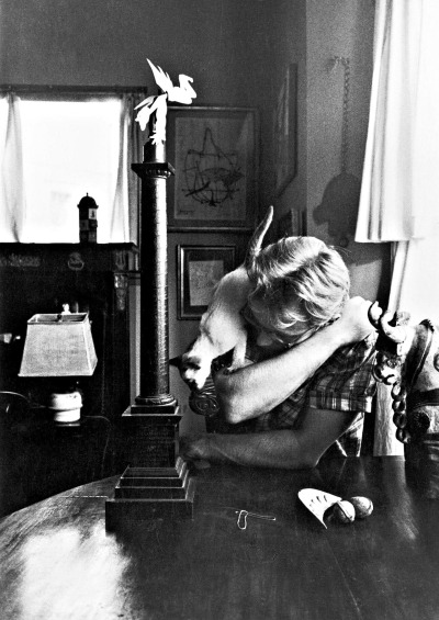 James Dean and his cat.  Photographed by Sanford Roth.