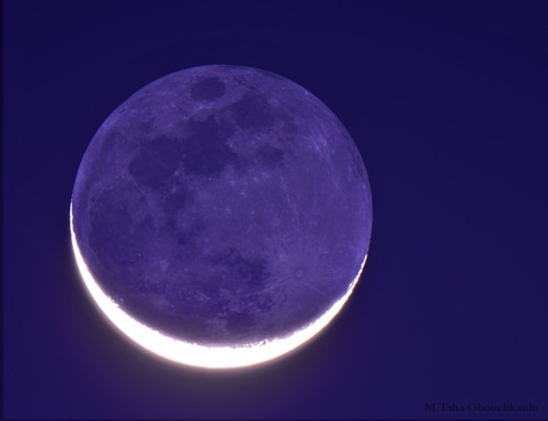 The New Moon in the Old Moon's Arms  Image Credit & Copyright:  M. Taha Ghouchkanlu  Explanation:  Also known as the Moon's ashen glow, Earthshine is Earthlight illuminating the Moon's night side. Taken on Nowruz, the March 20 equinox, from Esfahan, Iran, planet Earth, this telescopic image captures strong Earthshine from an old Moon. The darker earthlit disk is in the arms of a bright sunlit crescent. But the view from the Moon would have been enchanting too. When the Moon appears in Earth's sky as a slender crescent, a dazzlingly bright, nearly full Earth would be seen from the lunar surface. The Earth's brightness due to reflected sunlight is known to be strongly influenced by cloud cover. Still, a description of Earthshine, in terms of sunlight reflected by Earth's oceans in turn illuminating the Moon's dark surface, was written 500 years ago by Leonardo da Vinci. NASA APOD, 24 March 2012