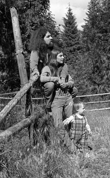 """Bruce and Family, Ashland, Oregon 1974"" In the early 70's a migration occurred. Many of my friends headed west from Boston. Some had just finished college while some had just had enough. A group of them landed in Southern Oregon, seeking a new life, experimenting with that Utopian concept better known as a ""commune"". Most of my friends established their new homes in 1972, I venturing out two years later. They worked the land; lived in group homes they built and let their hair grow long. And many of my friends had begun families.  As many of the men left to seek a new life, one that departed from the status quo of the time, equally of note were the single mothers who had migrated to this lifestyle as well. Many, having begun lives in the suburban dream of Southern California migrated north. The era called to them to find themselves. And many discovered that the conventional life of wife, mother and homemaker was not their calling after all. My circle of friends, now including partners and children had expanded exponentially since I last saw them Everybody lived together, farmed together and survived together. It was the start of a new world."