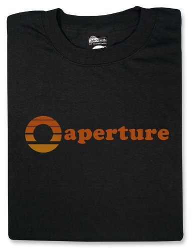 Aperture Logo (1970s) T-shirt at $19.99 Aperture Laboratories will conduct a groundbreaking for its Enrichment Center this upcoming Sunday. The public is invited to attend the 10 a.m. ceremony. Plans are for the cutting-edge center to include test chambers, offices, and a commercial kitchen. In addition, Aperture CEO Cave Johnson will be in attendance to talk with the public about Aperture Laboratories' new, exciting tripartate strategy: the Heimlich Counter-Maneuver, the Take-A-Wish Foundation, and the 'Portal' project, for which the Enrichment Center is being created. Recruiters will be also on site to sign up any citizens who would like to be test subjects for these new, exciting technologies. It is a source of great satisfaction to Aperture that it is poised to make a contribution of this caliber to humanity. Note: Aperture CEO Cave Johnson regrets he will be unable to attend the festivities.