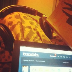 My saturday night, and who said men cant multitask? #music #ipad #book #reading  (Taken with instagram)