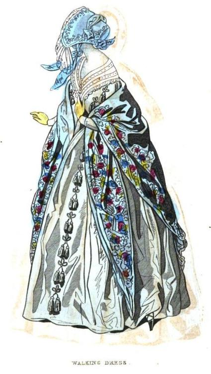Cabinet des Modes, Walking Dress, October 1841.  What a striking shawl!  It's nice paired with the bright blue bonnet but a very light and un-ornamented gown.