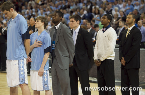 Kendall Marshall (5) stands behind his teammates in a suit during the playing of the National Anthem prior to their game against Ohio.
