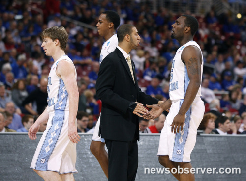 Kendall Marshall, center, encourages his teammates, including UNC's P.J. Hairston (15) as they come back to the bench during the first half of North Carolina's game against Ohio in the Sweet 16.