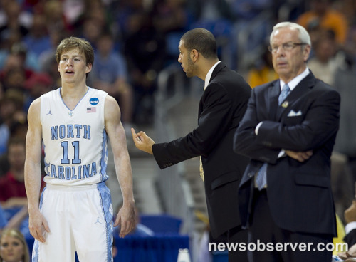 UNC's Kendall Marshall (5), out with an injured wrist advises Stilman White