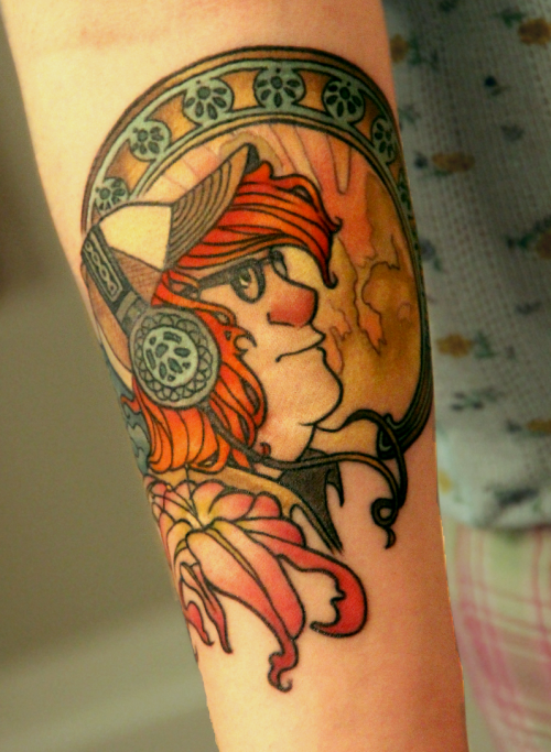 My Alphonse Mucha inspired tattoo is finished. It is my first tattoo and I love it so much! My artist is Perry from Splash of Color in East Lansing, MI.  This is from my own drawing, and is of my own character, Rob. I had submitted a work in progress photo before but thought you all might like to see it finished.