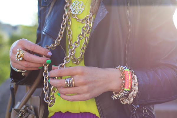 Pile on the chunky accessories and add some neon pops of colour here and there.