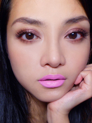 Weekend Face: Chanel Illusion D'Ombre 86 Ebloui and Lime Crime Great Pink Planet Opaque Lipstick —- I posted this on Facebook some time ago and was asked what products I used for this weekend look. Was feeling a little luxe, but you can definitely substitute the products I used with others. Eyes:  Chanel Illusion D'Ombre 86 Ebloui: Deep rich reddened brown with green, gold, pink sparks that look a lot prettier in real life than they show up on camera. Very beautiful. Also very expensive. I got it with a gift voucher and I'm not suggesting that you do the same unless you badly want a one-step product that goes on very smooth and even (compared to most other similar products on the market), is chock-full of multidimensional sparkles, and won't need to be set with a powder shadow. It does set completely and doesn't feel tacky or greasy to the touch.  (Alternatives: Laura Mercier Metallic Creme Eye Colour in Burnished Copper or MAC Constructivist Paint Pot are not sparkly, but give a similar look overall.)  L'oreal Voluminous Carbon Black Mascara Cheeks: MAC Mineralize Skinfinish in Blonde (limited edition - use any soft pink shimmery blush) Lips: Lime Crime Great Pink Planet lipstick (Alternative: Barry M Dolly Pink)