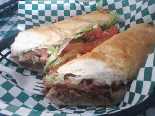 A Parasol's Roast Beef Po Boy. It was absolutely gorgeous to eat. Yes, the adjective doesn't match up.  That's the best way to describe this though!Tap the bread and it's hard. But don't think it's like that all the way through. A crispy, crunch exterior yields a fluffy, white interior. Ah yes. French bread. Your teeth sink through the bread and you hit the fillings on either side. But if your bite isn't as clean as you think… a whole bunch of stuff falls out. Mayo slathered lettuce, slices of tomatoes, pickles, gravy, roast beef. It's ok. It'll still wind up in my mouth. But there's a nice combination of roast beef slices and gravy that made me want to wipe down the drippings with the bread so that none of the bread I ate was white anymore. When Wen and I walked in, we stumbled into a cramped bar. And then the bartender asked if we wanted to sit in the dining area, which seemed like a better idea! Cause I can't legally by alcohol yet. So the dining room is in two rooms, the tables are sorta sticky in that old diner grease kind of way, and your order at the window. The whole place was plopped right in the middle of the neighborhood. If I lived in that hood.. I'd hang out there all the time.  Nom nom nom