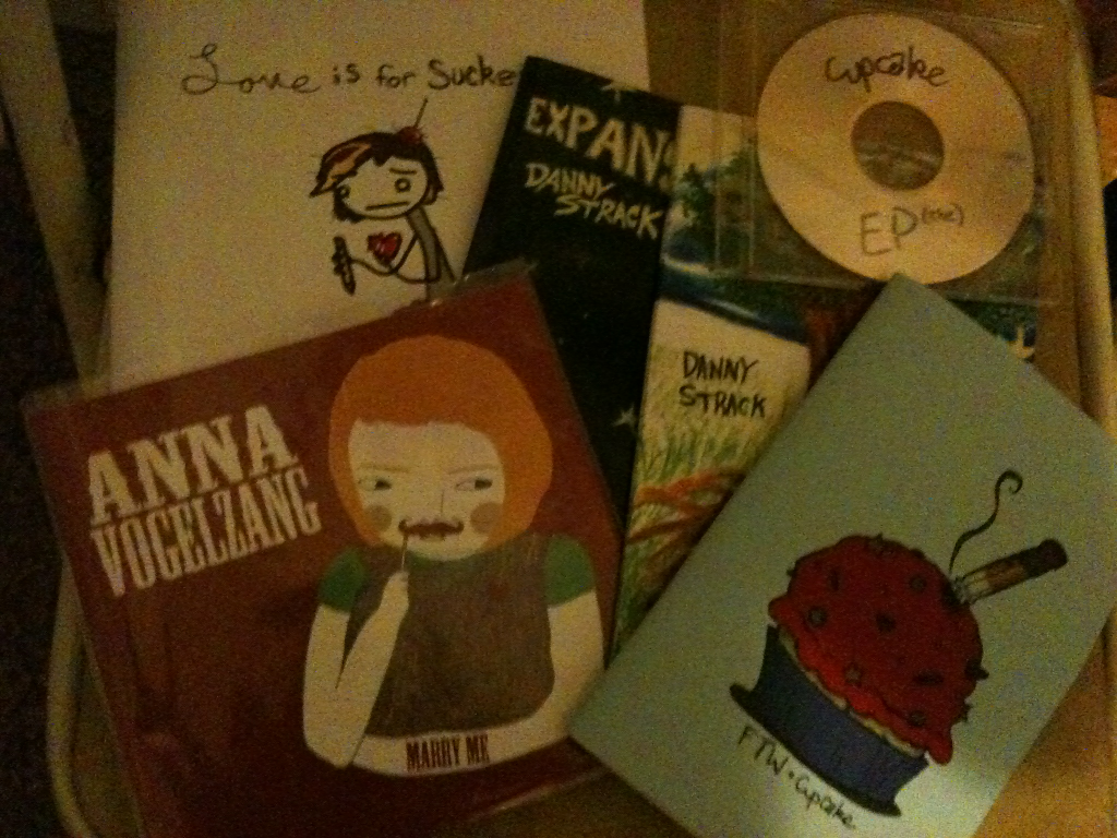 Merch haul from the show I went to last night.  7 inch from Anna Vogelzang, very fun musical performer.  An EP and two books from Cupcake, a poet I just heard of.  ANNND two books from Danny Strack, one of my favorite poets in the world, no foolin'.  Support the people who come through your town people.