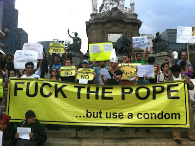 christiannightmares:  Activists in Mexico tell the Pope to bend over (Found at Joe. My. God.; For a related video, click here http://christiannightmares.tumblr.com/post/2327306501/topless-male-acrobats-give-pope-benedict-xvi-a)