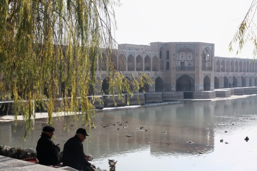 Two men share a cup of tea on the banks of Zayandeh River in Esfahan, Iran - December 2009