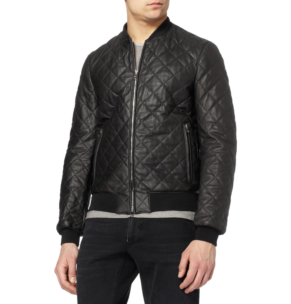 Gucci Quilted Leather Bomber Jacket Details & Care Black quilted leather bomber jacket Two zipped front pockets, ribbed collar, cuffs and hem Zip closure 100% leather; lining: 100% cotton; filling: 100% polyester; knit details: 81% cotton, 16% nylon, 3% elastane Specialist leather clean Made in Italy  (vía MR PORTER) OMG!