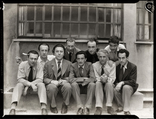 gldfrd:  The surrealist group in 1930 (left to right, back row) Paul Eluard, Jean Arp, Yves Tanguy, Rene Crevel, (front row) Tristan Tzara, Andre Breton, Salvador Dali, Max Ernst, Man Ray