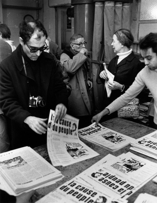 oldhollywood:  Jean-Luc Godard, Jean-Paul Sartre, and Simone de Beauvoir gather to distribute copies of the Maoist newspaper La Cause du Peuple on the street after it is banned by the government (Paris, 1970). Photographer: Bruno Barbey (via)