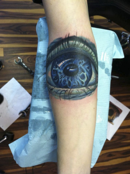 "fuckyeahtattoos:  This is my ""Macro eye"" tattoo done by Halo. Tattoosbyhalo.com Ever since I was a little kid, I always found eyes to be the most attractive feature on others. When I started high school, I was introduced to Macro Photography, and discovered how beautiful and unique each individual eye is."