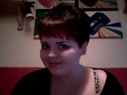 So i got my hair cut and re-dyed my fringe to a darker red :D yay