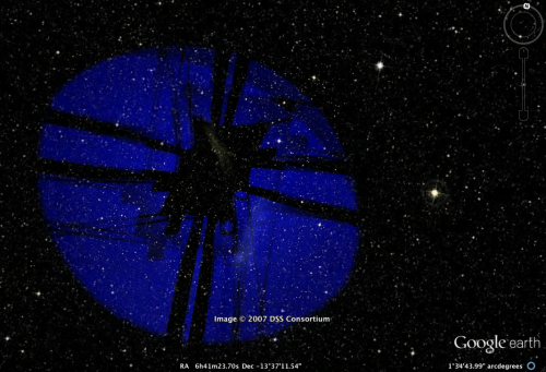 "codenamelooker: Have you seen this image before? It can be seen in google sky, right next to Sirius, the dog star.  If you look closer you can see other aircraft-like lights. It's crazy! There are a lot of evidence about a ""glowing wheel"" that visited earth long ago in many ufo sites. ;_;  Thanks for the submission! Kind of looks like a satellite's reflection but intriguing nonetheless."