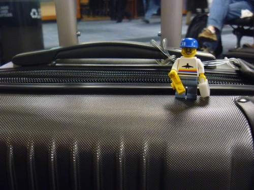 I made a minifigure of myself to document my trip!  Note the blue hat, beard, smile, awesome T-Shirt and blue pants.  Just like me!  I can't always take pictures of myself doing cool things (or else they would look like MySpace shots) but I can take pictures of my Sig-Fig (A Lego minifigure that looks like yourself). Here I am with my luggage and a camera in Dulles Airport!
