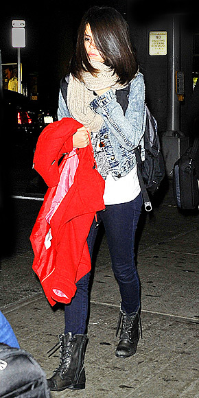 Boots, $101.98  Selena Gomez  Rocking a light jean jacket and indigo skinnies with a long-white shirt, plus midcalf lace-up boots.