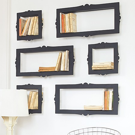 Avant-garde baroque style, black metallic bookshelves with an ornate frame shape. Each book shelf is open at the side and this unique shelving idea looks great when mounted individually but really terrific in a set of multiple shelves. (via Baroque CD, DVD or Bookshelves)