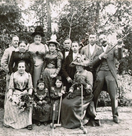 Georges Méliès (far right, standing) with his wife, Eugénie Genin (seated, with hat), and other relatives, circa 1890 (via)