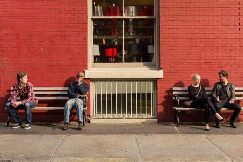 red brick wall and benches