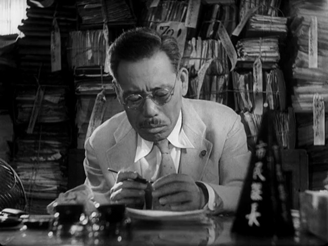 "Ikiru (1952) BEAN'S TOP 5 JAPANESE FILMS: NUMBER 5 - IKIRU It's my turn now! I found it very difficult to choose my favorite Japanese films. This is not because I have seen so many, which is true, but because there are many films I love and I think everyone should see- but I have no interest in seeing again. So I've decided to cut those films out for now and focus on my watchable favorites and not the ones I think you should see. Maybe I'll make a ""5 Japanese films I think you should see but will probably scar you for life"" list later.  SO, Ikiru is a film about a classic 'salary man' bureaucrat in a broken, useless government job who realizes he wants to find meaning in his life. It's a sweet, heart-warming film that makes you want to live life to the fullest! It's also a really good look-if not a slightly caricatured version- of what life is like working for a Japanese company or Government office. While things aren't that bad for some, many people in Japan do work ludicrous hours for no over time and are unable or feel unable to take days off. They work all day long and at least from what I've seen, they often aren't working hard, they just feel obligated to look like they are working and stay late.  This being one of Kurosawa's earlier films I feel like his style is a little raw and even over the top- in a good way. Kurosawa frames scenes to visually represent the feelings and relationships of his characters, all over the place. Seriously just pay attention to the how the characters are placed in a scene and you'll realize that practically everything around them informs you about who they are, what they feel, or what their relationship is with the other characters in the scene. A very fun and interesting watch."