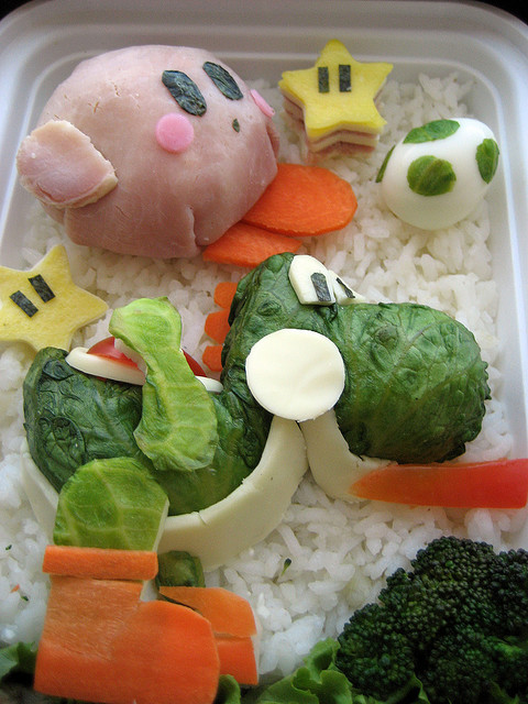 alloftheyoshis:  Low angle detail of Yoshi Smash Bros. bento by AnnaTheRed on Flickr.