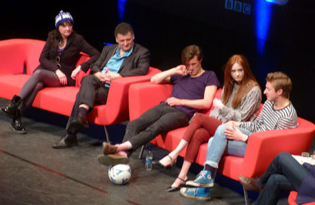 "'Doctor Who' Convention Report 5 (Day 2): Daleks, Butterflies and Jelly Babies This is Anglophenia's best roundup yet, complete with some funny bits, some adorable bits, and an audience response that we found legitimately shocking — and we don't mean the Rory thing listed below (you have to click through to find and look for the ""jarring"" bit).  Here's what else we've learned today: • An interesting discovery that came out of this morning's Meet The Stars panel is that Karen Gillan is terrified of things that buzz and fly, as a lot of people are. She's scared of moths, she's scared of midges, and she's scared of butterflies. Actual butterflies. I know! • Steven Moffat's standard answer to any question about future episodes of the show is a delightedly sing-song ""I'm not telling you!"" • Arthur Darvill told an amazing story of a man he met who said he had meticulously arranged his wedding day so that there was an hour-long break to watch Amy and Rory's wedding, which happened to be live on TV on the same day. • A very keen Whovian called Jordan offered a jelly baby to the panel, and got a jammy dodger in return from Matt Smith. • Caroline Skinner was wearing a knitted TARDIS hat, given to Karen Gillan the day before by a fan. • Due to collective silliness, all three stars of the show took to the stage for one of their Meet The Stars panels using huge balletic leaps. Matt then embarked on a keepy-uppy of a soccer ball, reaching 50 kickes, but only on the condition that people in the audience would donate money to the BBC's Sport Relief charity. • During an aside about the amount of times Arthur has had to play death scenes, Steven ominously rumbled: ""and you ain't seen NOTHIN' yet!"" (This rather shocked the audience for a moment, and completely derailed Steven's train of thought)  via Anglophenia"