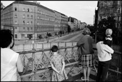 West Germans looking over the Berlin Wall to East Berlin, 1965.