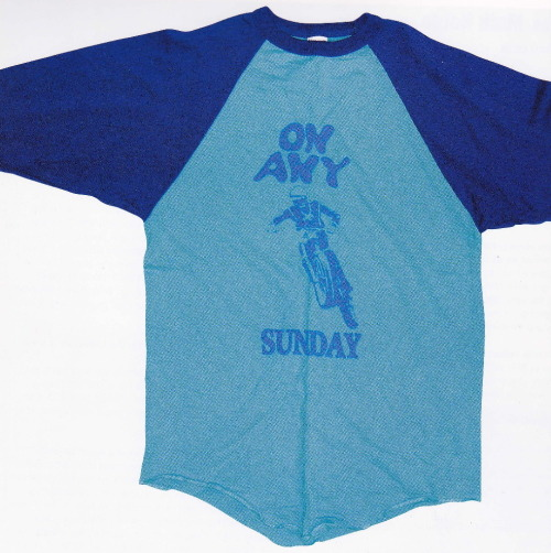 dennishopper:  T shirt for On Any Sunday, an old Steve McQueen dirt bike film, early 1970s. I have this book called Vintage T-Shirts that a friend got me years ago, and I just started browsing through it again. Its simply fascinating to see the development of pop culture and subculture partly manifested through such a recognizable and widely used article of clothing. Over the course of the next few days I'll be posting scans of t shirts from the book because the shirts are interesting- and nowadays- hard to find. I recommend the book too, that way you can see for yourself how far the t-shirt has come as a form of expression and identity. Vintage T-Shirts by Lisa Kidner and Sam Knee