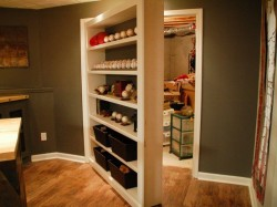 hiddenbookcasedoors:  Secret bookcase door opens to reveal hidden storage room