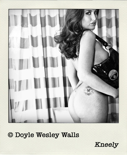 © Doyle Wesley Walls — Kneely Models Her Purse