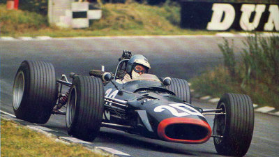 banking …Piers Courage, BRM P126, 1968 British Grand Prix, Brands Hatch